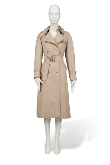A three-quarter length trench coat, Burberry, early 1980s. Estimate £6,000-9,000. This lot is offered in Audrey Hepburn The Personal Collection on 27 September 2017  at Christie's in London