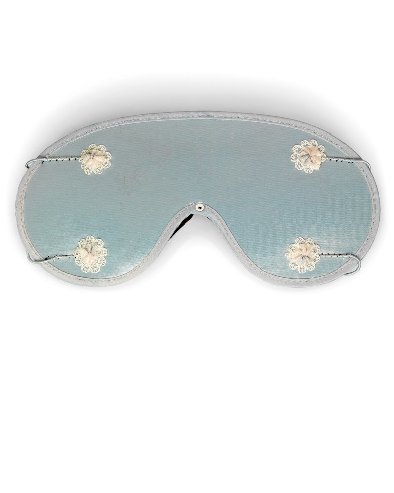 A sleep mask, Sleep shade co., circa 1960. 8  in (20  cm) long. Sold for £6,250 on 27 September 2017  at Christie's in London