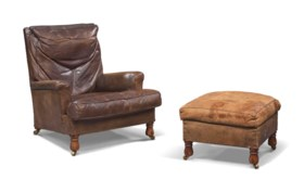 AN ENGLISH BROWN-LEATHER AND OAK LIBRARY ARMCHAIR AND FOOT-STOOL