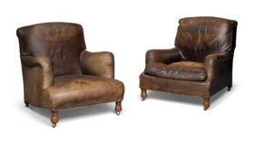 TWO ENGLISH BROWN-LEATHER AND OAK EASY ARMCHAIRS
