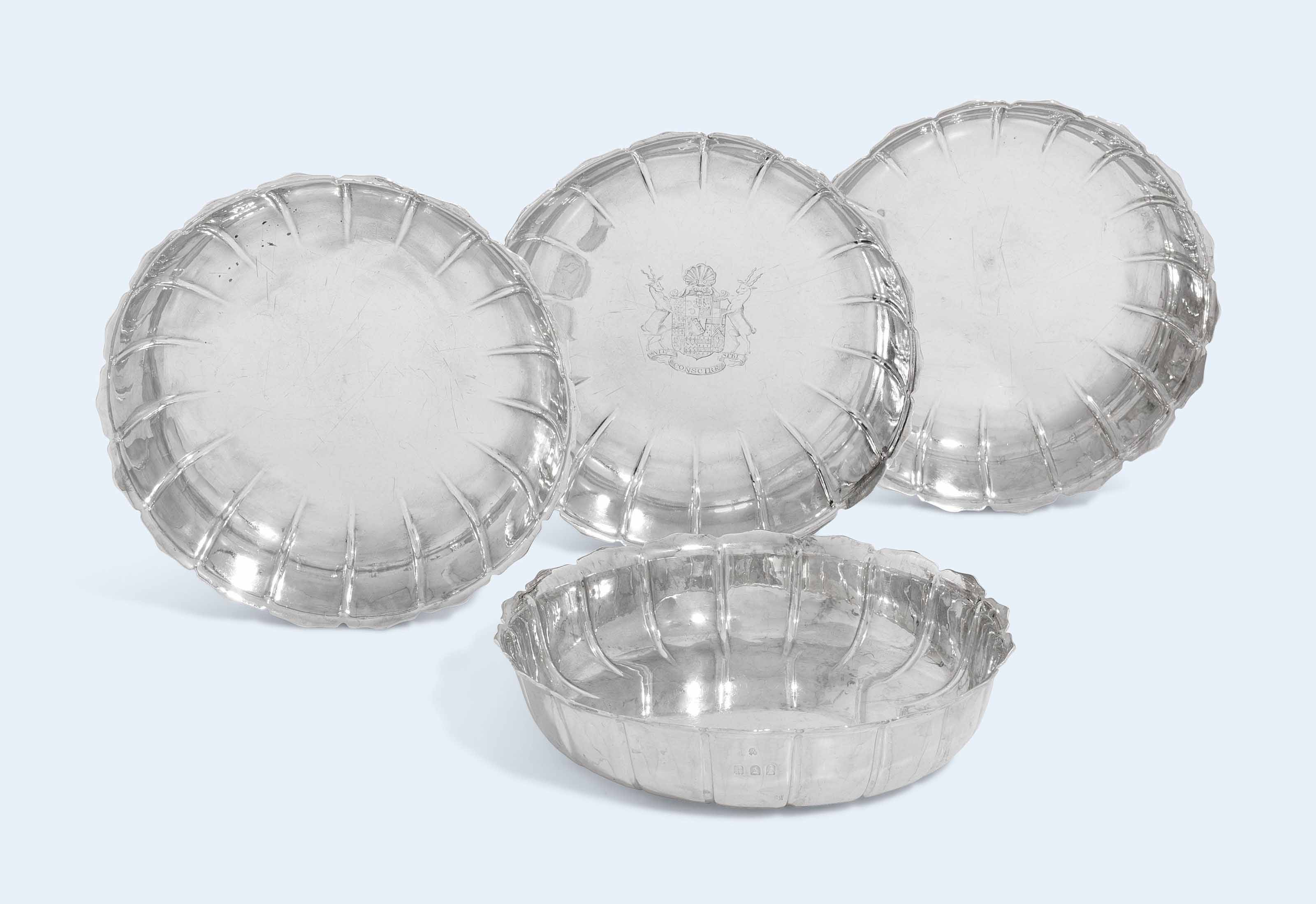 A GEORGE I SILVER STRAWBERRY-DISH AND A SET OF THREE EDWARD VII SILVER STRAWBERRY-DISHES