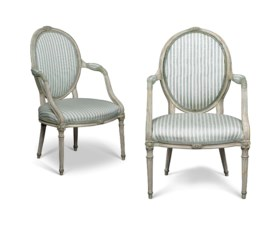 A MATCHED PAIR OF ENGLISH WHITE AND GREEN-PAINTED OPEN ARMCHAIRS
