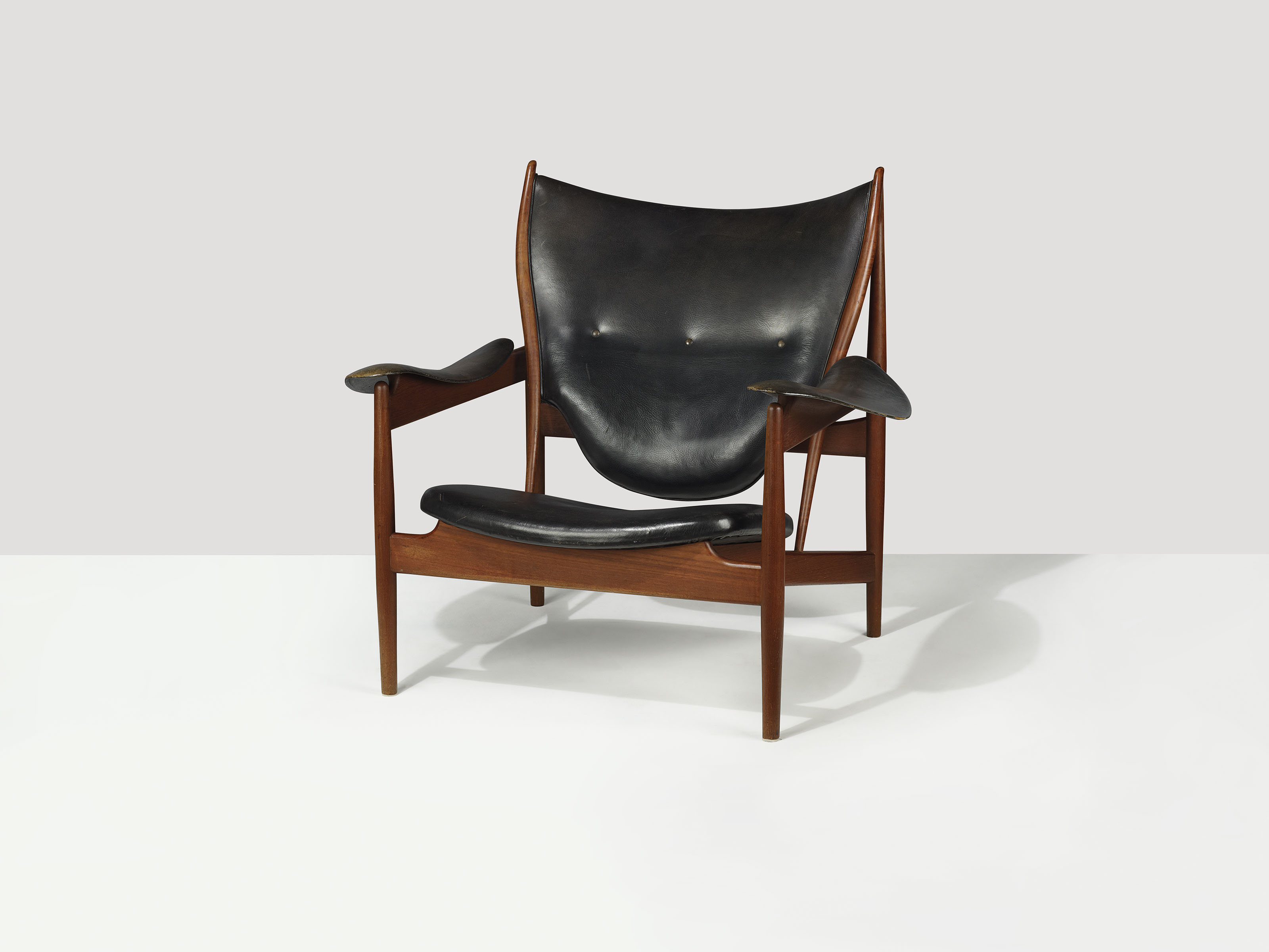 Finn Juhl (1912-1989),  Chieftain Chair, designed in 1949, this example executed mid 1950s. 36⅝ high x 41 wide x 35½  in deep (93 x 104 x 90  cm). Estimate £50,000-80,000. This lot is offered in Masterpieces of Design & Photography on 3 October 2017  at Christie's in London