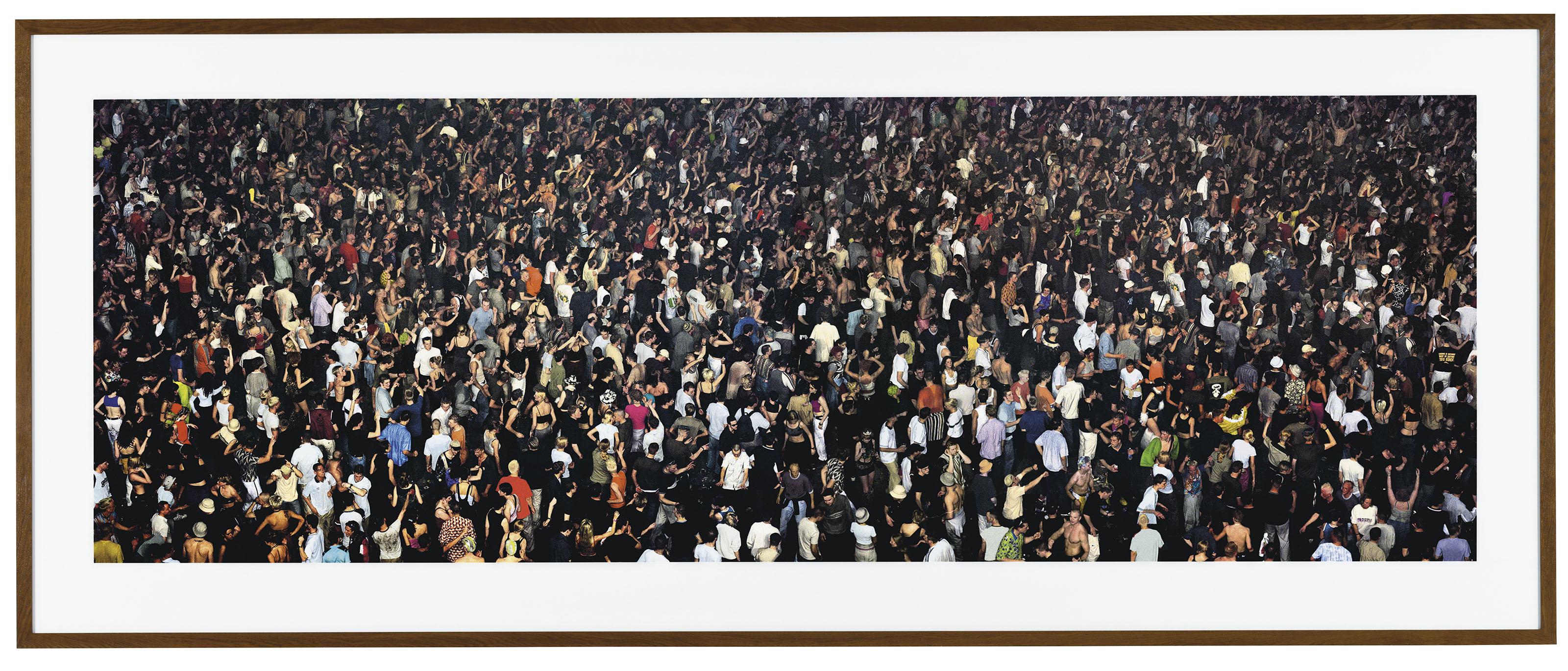 Andreas Gursky (b. 1955), May Day IV. Overall 82 x 200  in (208.3 x 508  cm). Estimate £500,000-700,000. This lot is offered in Masterpieces of Design & Photography on 3 October 2017  at Christie's in London