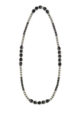 A NECKLACE OF JET BLACK BEADS