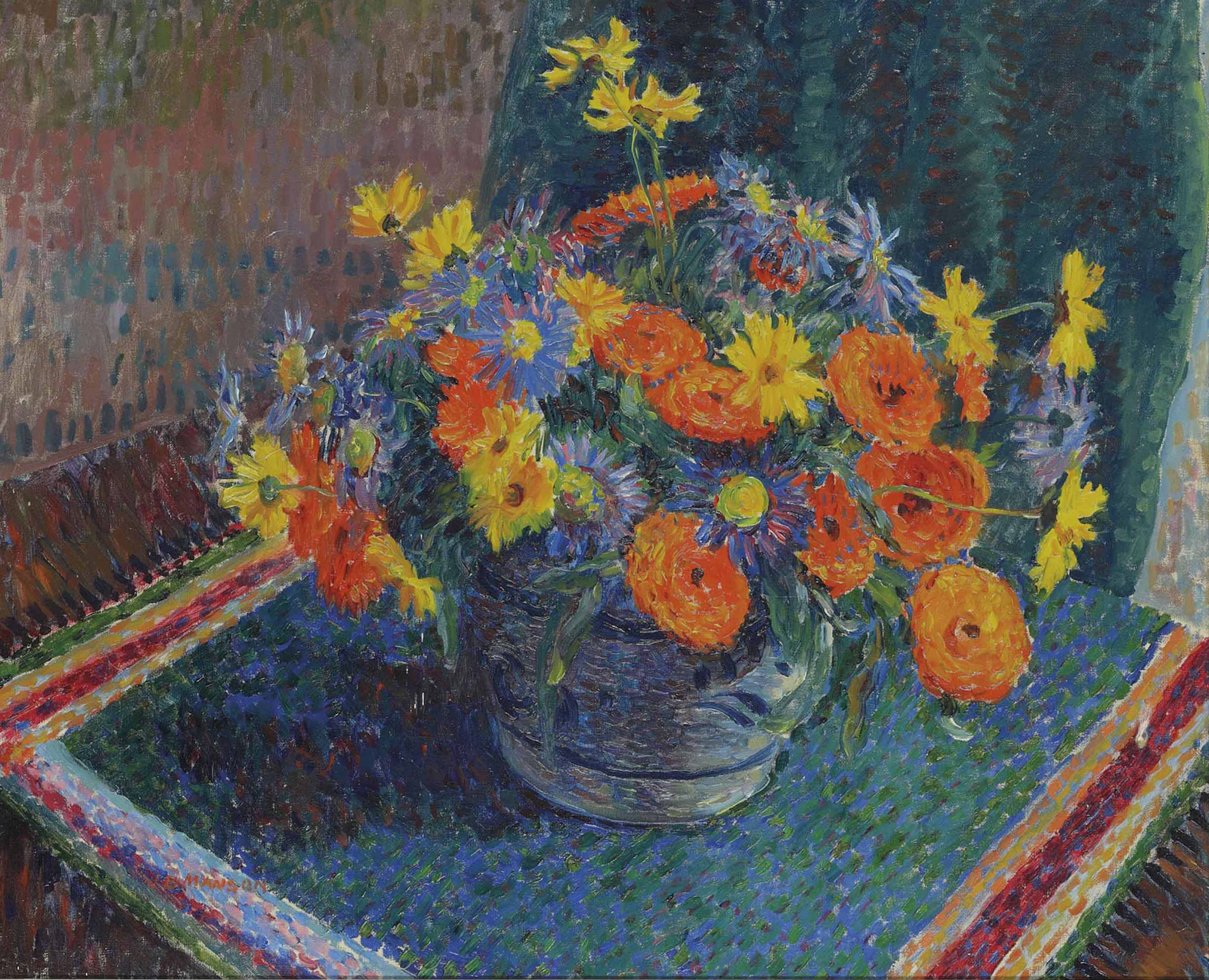 Summer flowers in a pottery bowl on a table