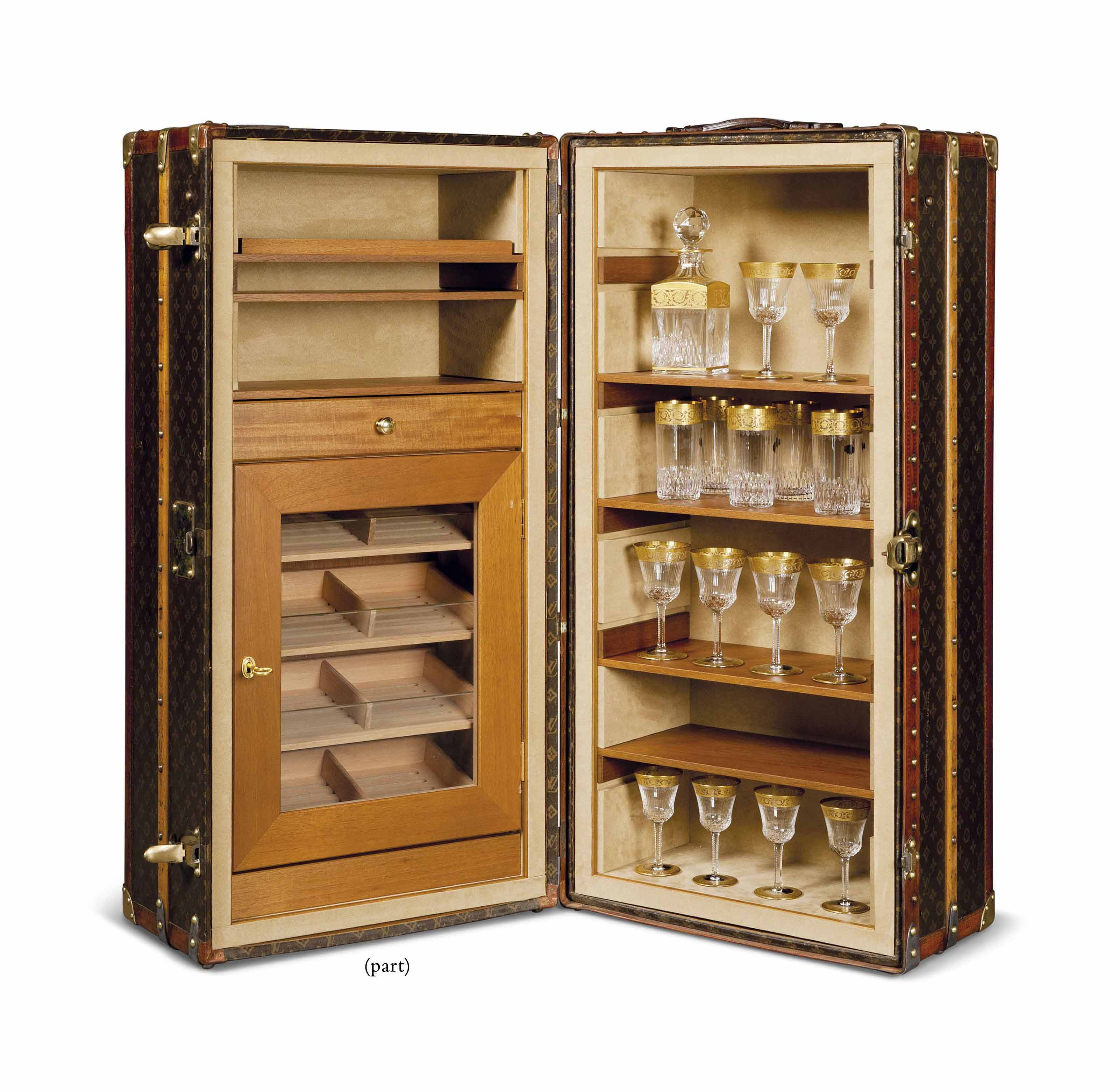 A LOUIS VUITTON WARDROBE TRUNK MODIFIED AS A COCKTAIL BAR AND HUMIDOR
