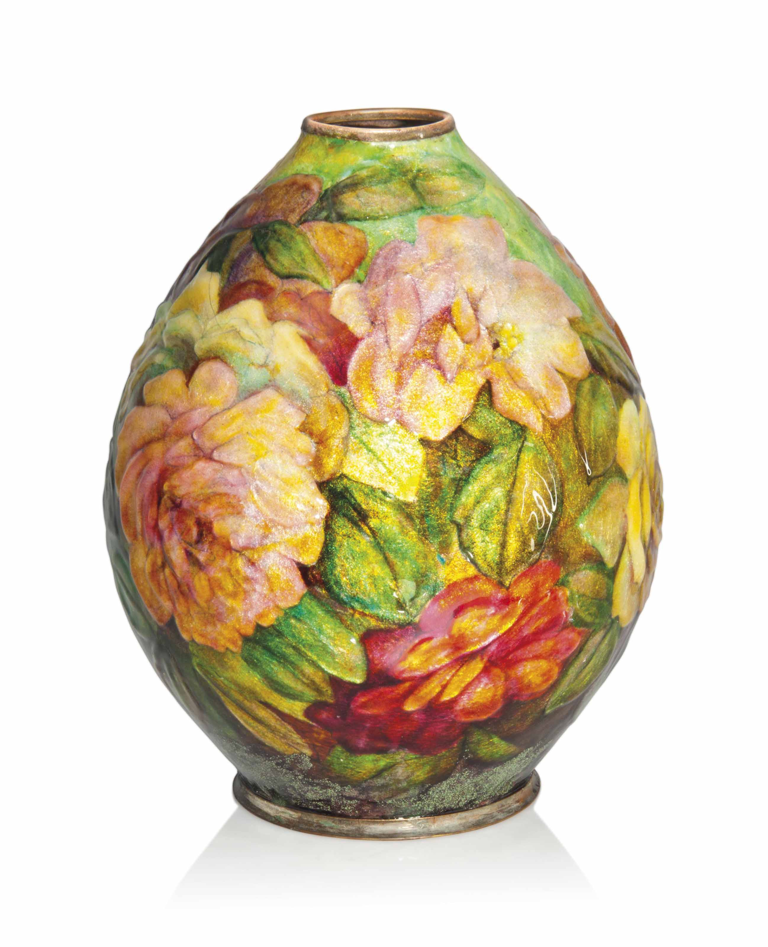 A CAMILLE FAURÉ (1874-1956) POLYCHROME ENAMELLED COPPER VASE DECORATED WITH FLOWERS AND LEAVES
