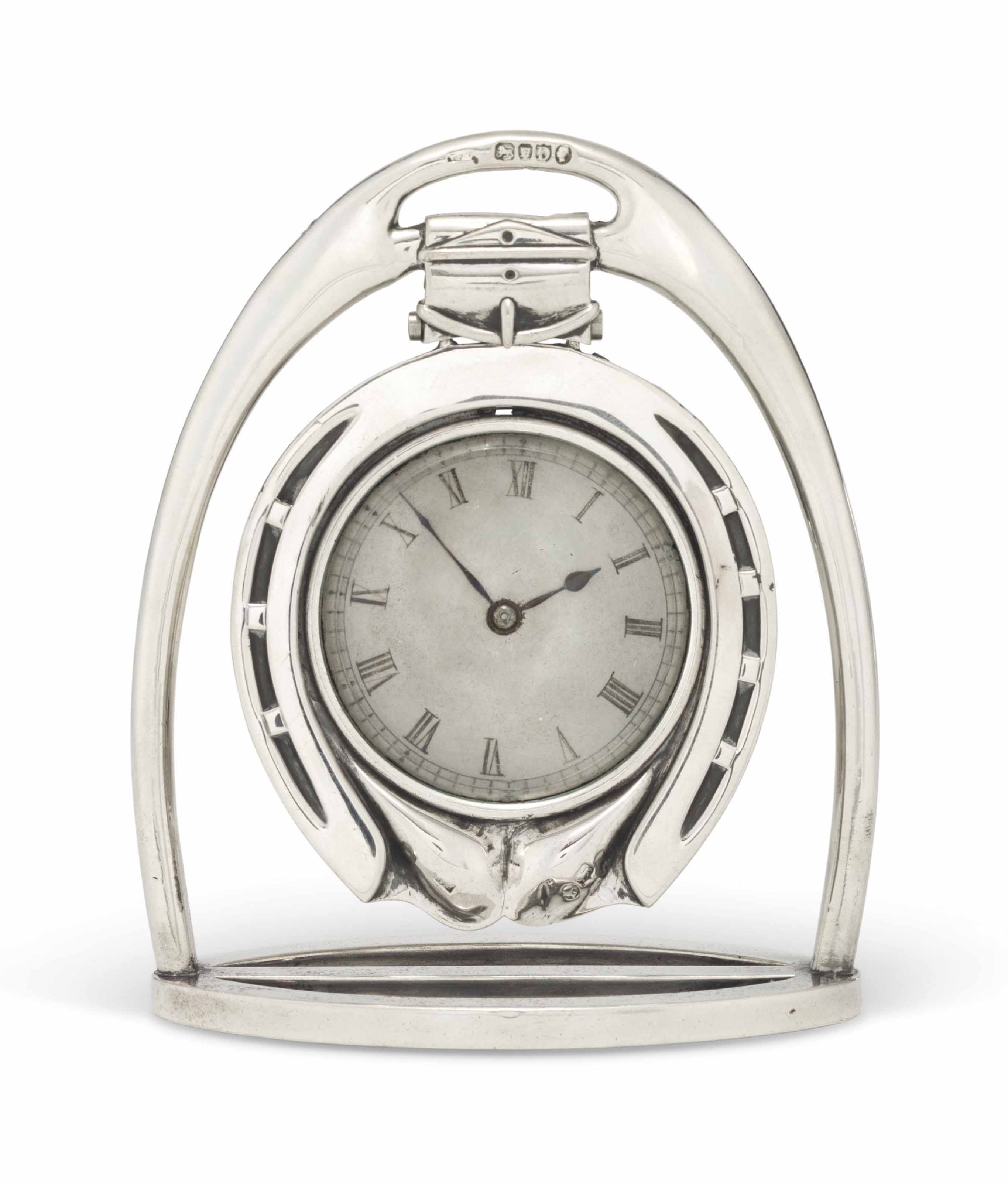 A VICTORIAN SILVER HORSESHOE TRAVELLING-CLOCK