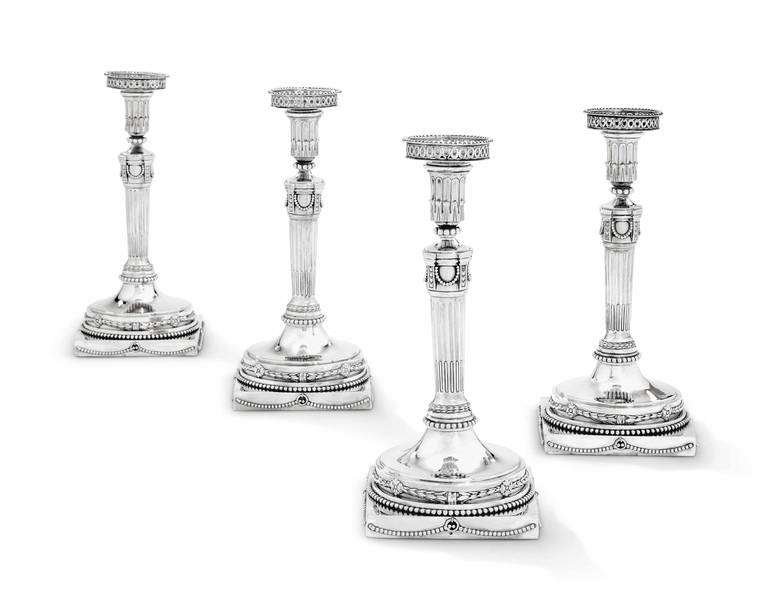 A SET OF FOUR DUTCH SILVER CANDLESTICKS