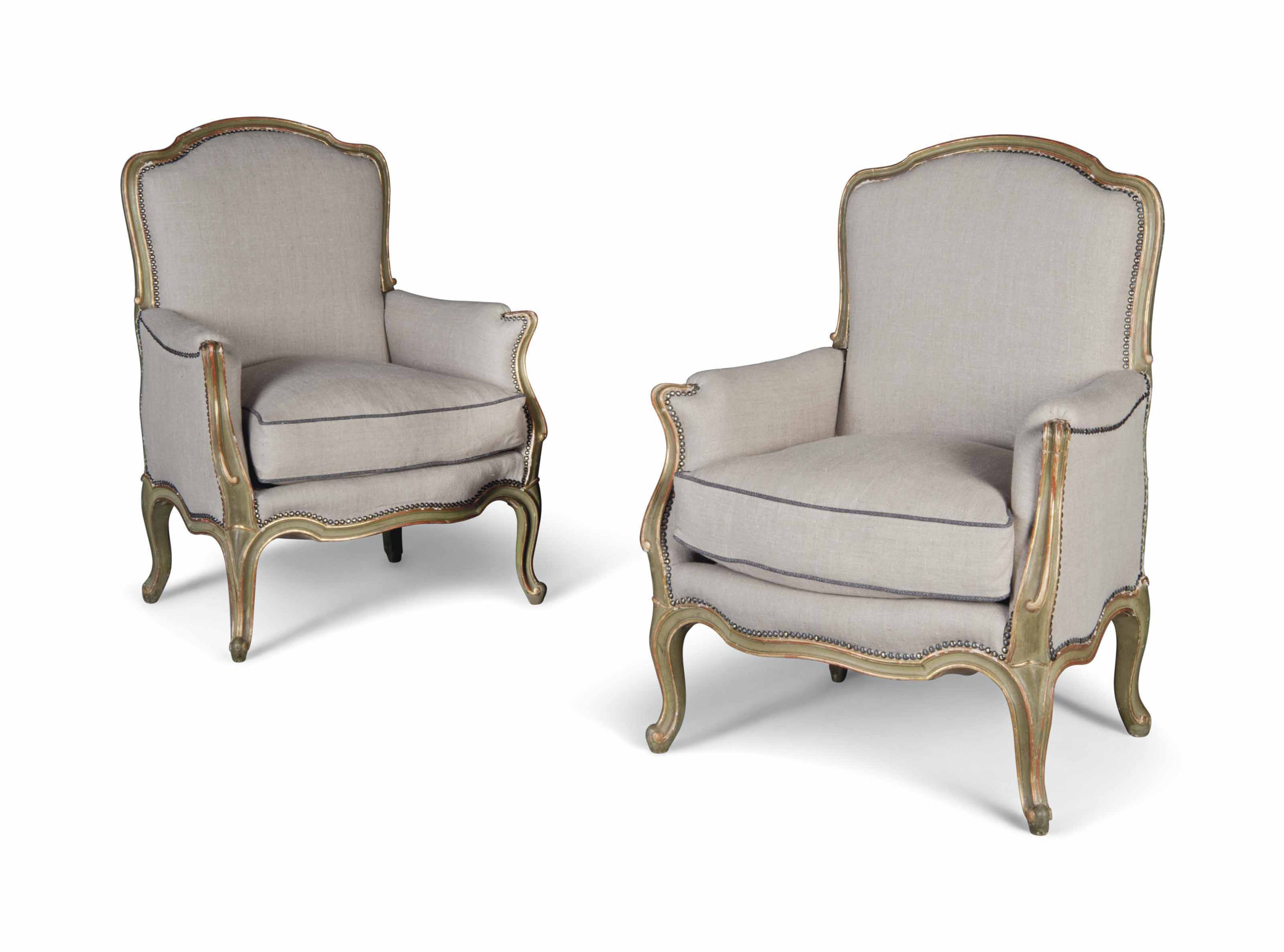 A PAIR OF PARCEL-GILT AND GREEN-PAINTED FAUTEILS