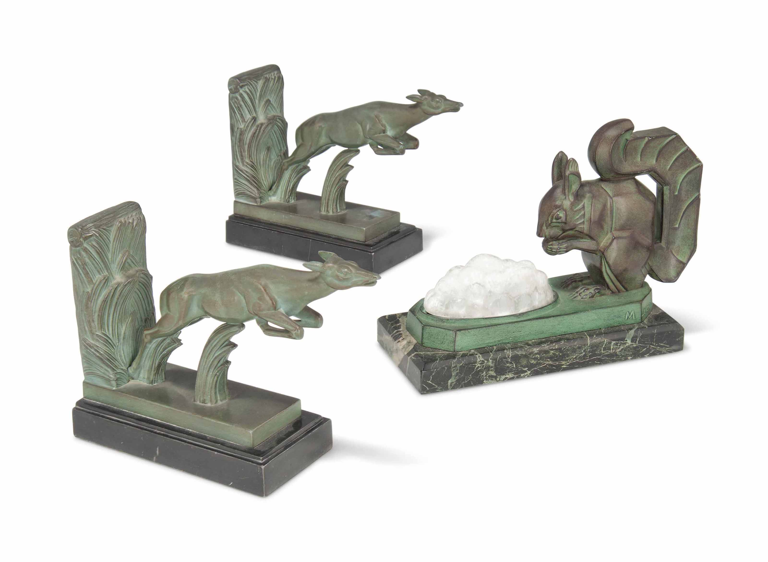 A MAX LE VERRIER COLD-PAINTED 'SQUIRREL' NIGHT LIGHT AND A PAIR OF 'DEER' BOOKENDS