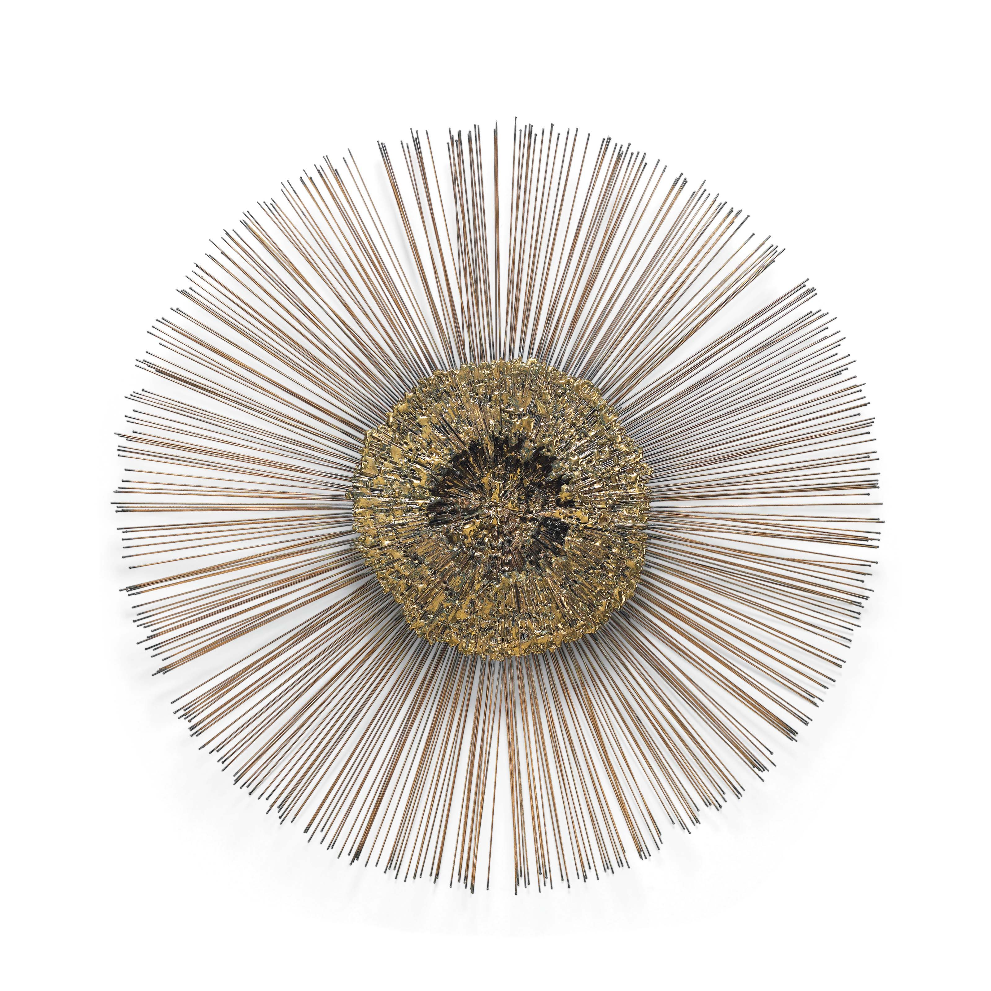 A COPPER AND BRASS PATINATED STEEL SUNBURST WALL SCULPTURE