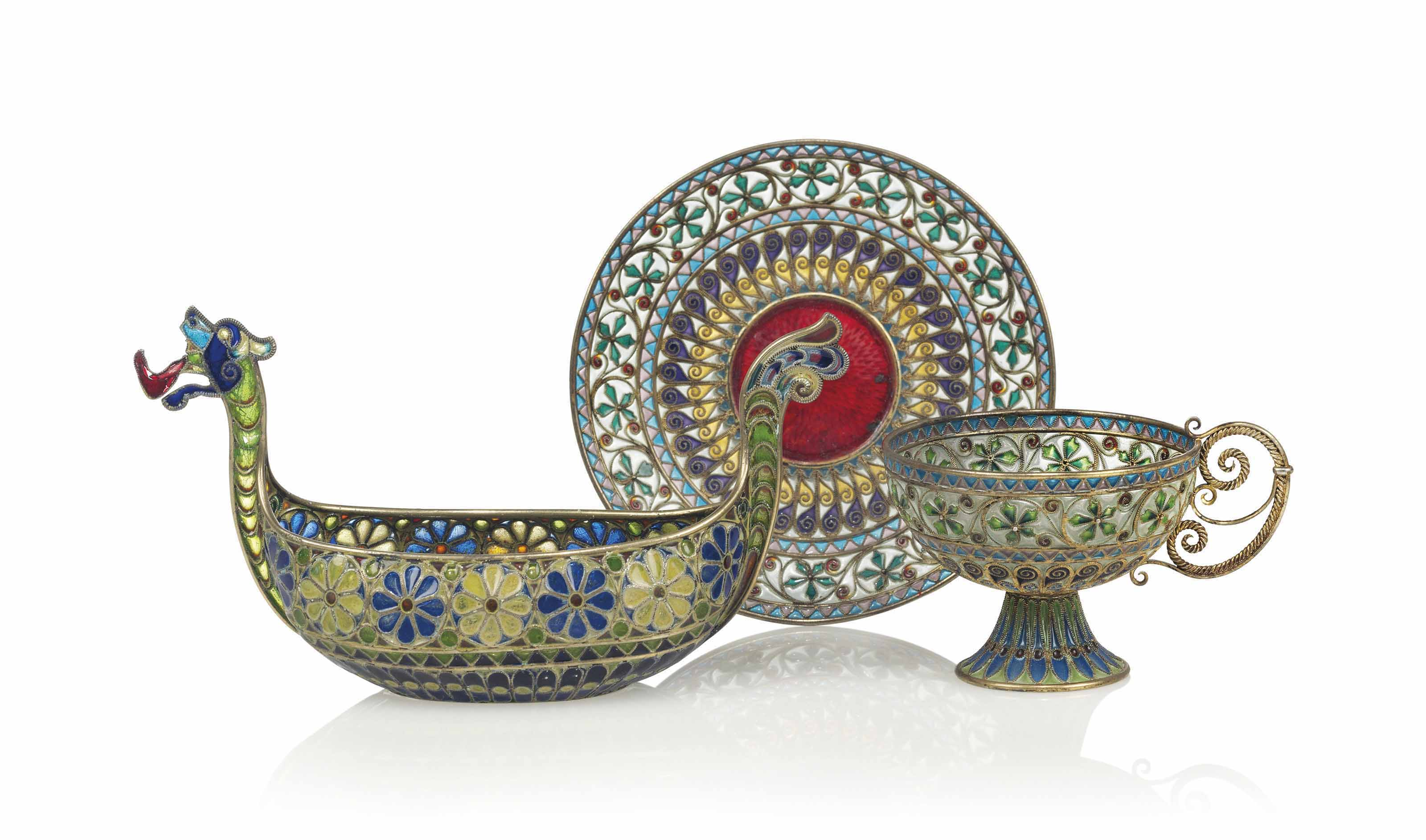 A NORWEGIAN SILVER-GILT AND PLIQUE-A-JOUR CUP AND SAUCER