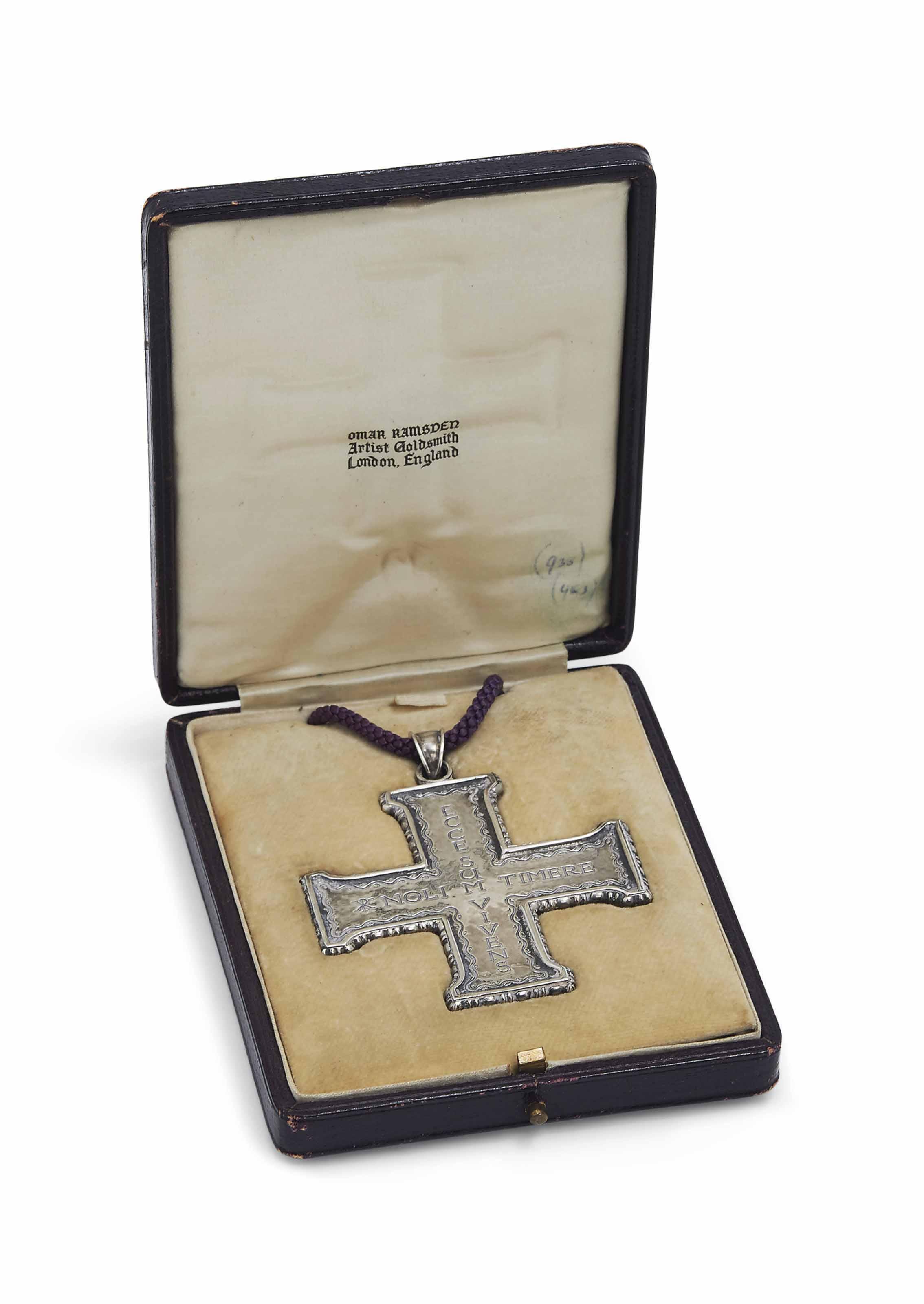 AN OMAR RAMSDEN (1873-1939) SILVER PECTORAL CROSS ON A PURPLE CORD IN ORIGINAL RAMSDEN BOX