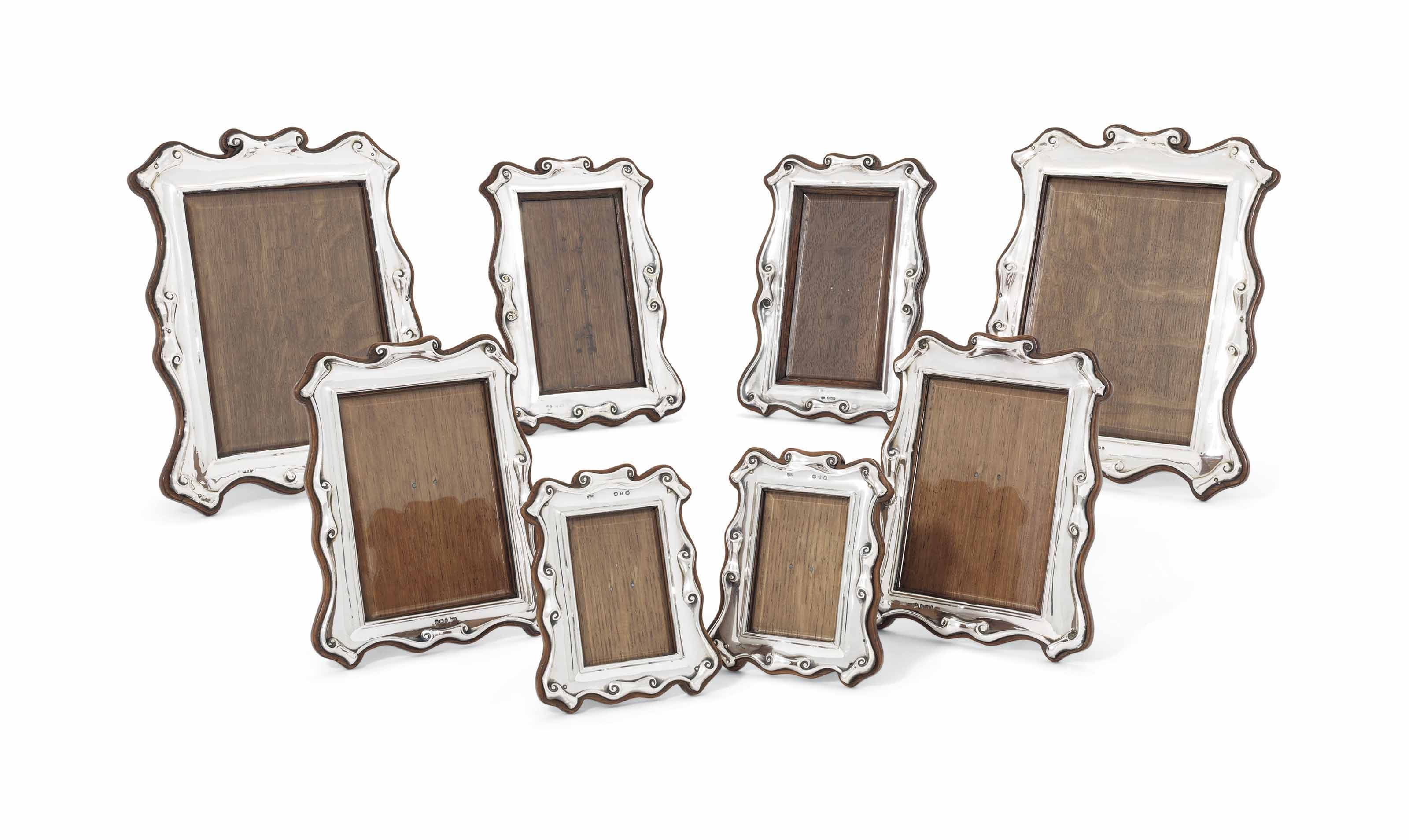 A SET OF EIGHT SILVER-MOUNTED PHOTOGRAPH-FRAMES
