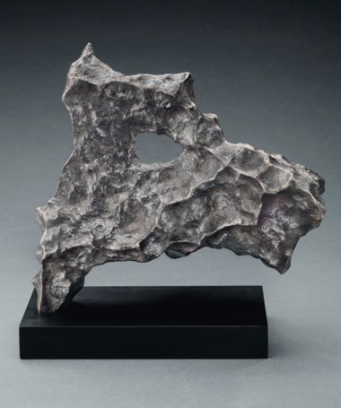 Rare zoomorphic meteorite from the Macovich Collection — with a naturally formed hole, 'The terrier from outer space', iron, fine octahedrite. Gibeon, Great Nama Land, Namibia. 8½ x 8½ x 4 in (214 x 214 x 103 mm). Sold for £68,750 on 27 April 2017  at Christie's in London, South Kensington