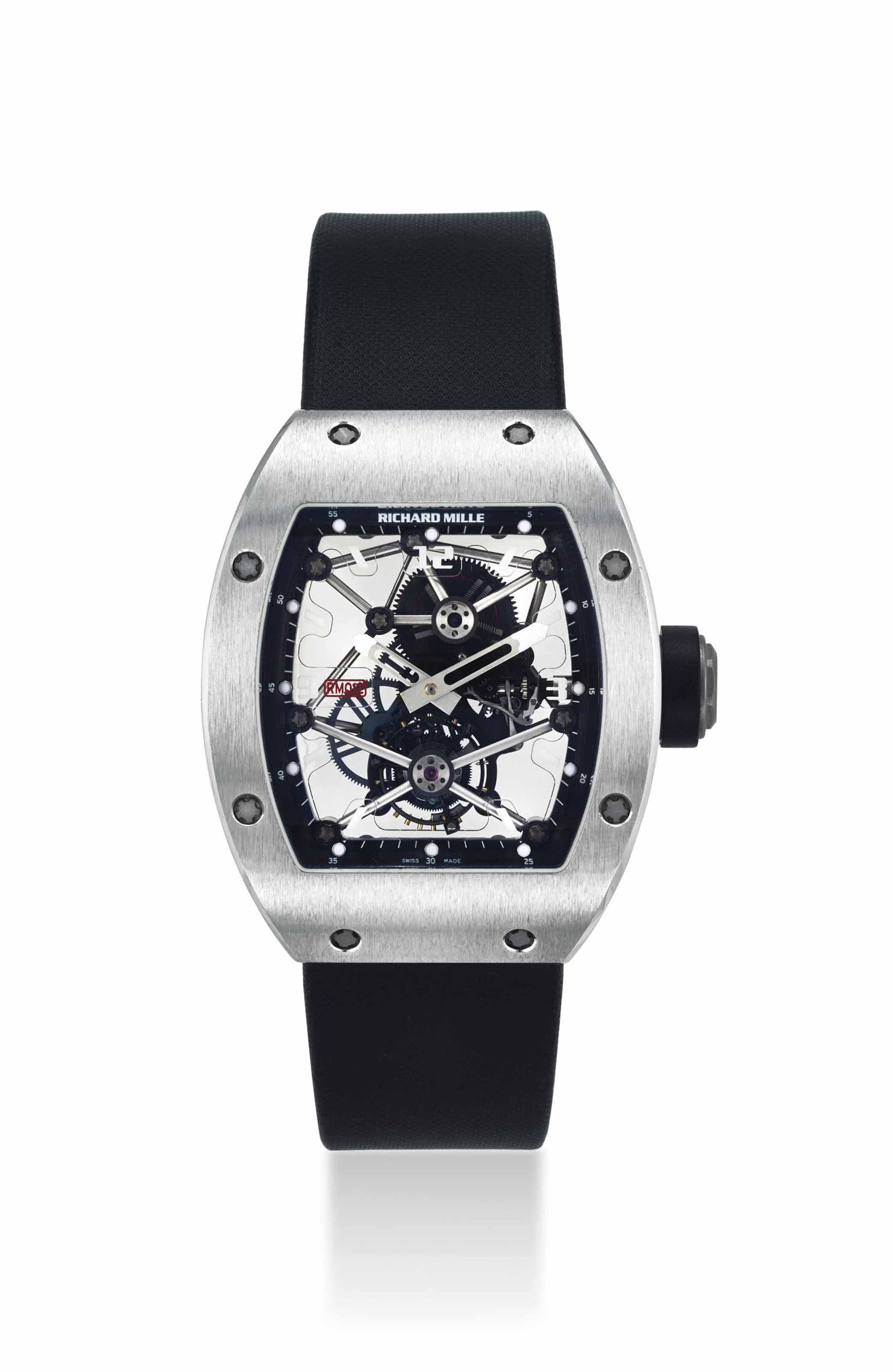 RICHARD MILLE. AN EXTREMELY FINE AND RARE PLATINUM LIMITED EDITION TONNEAU-SHAPED SKELETONIZED TOURBILLON WRISTWATCH