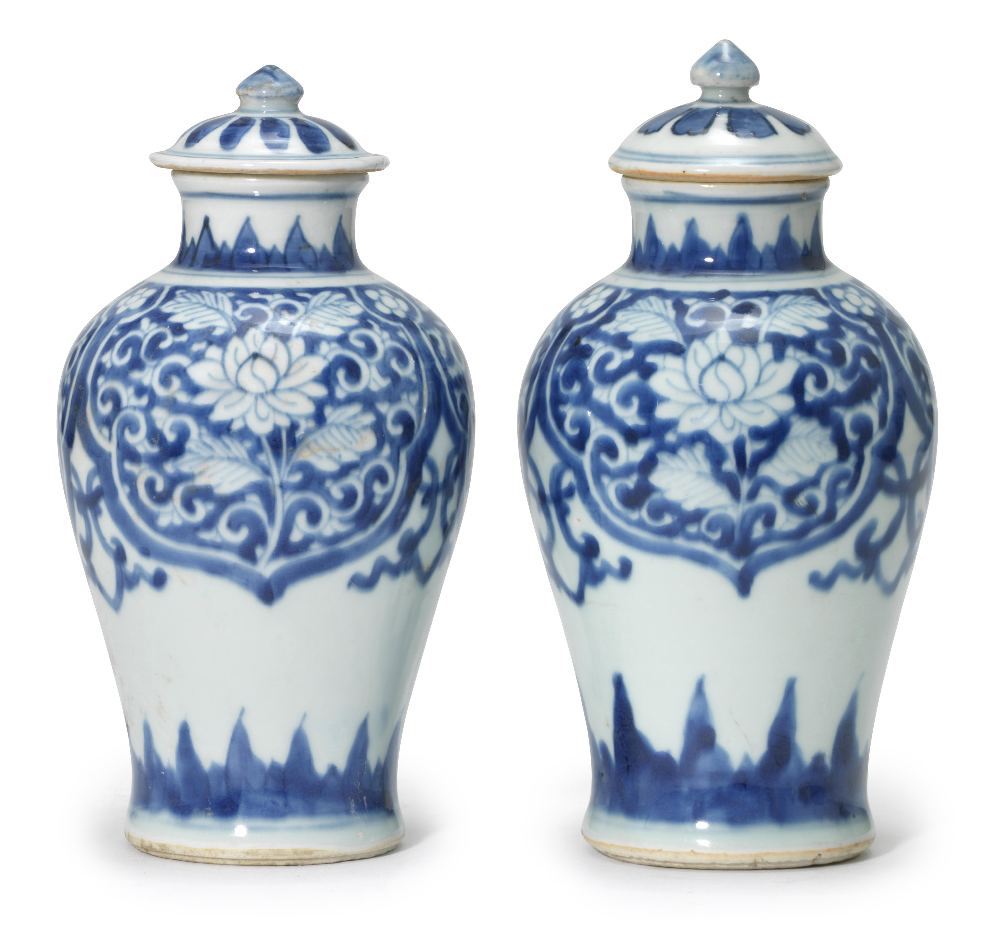 a near pair of small blue and white lotus baluster