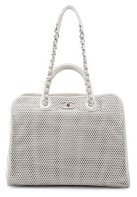 AN IVORY PERFORATED LEATHER