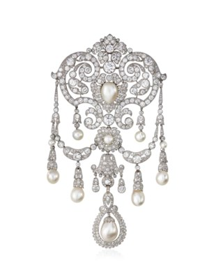 A BELLE ÉPOQUE NATURAL PEARL AND DIAMOND STOMACHER BROOCH