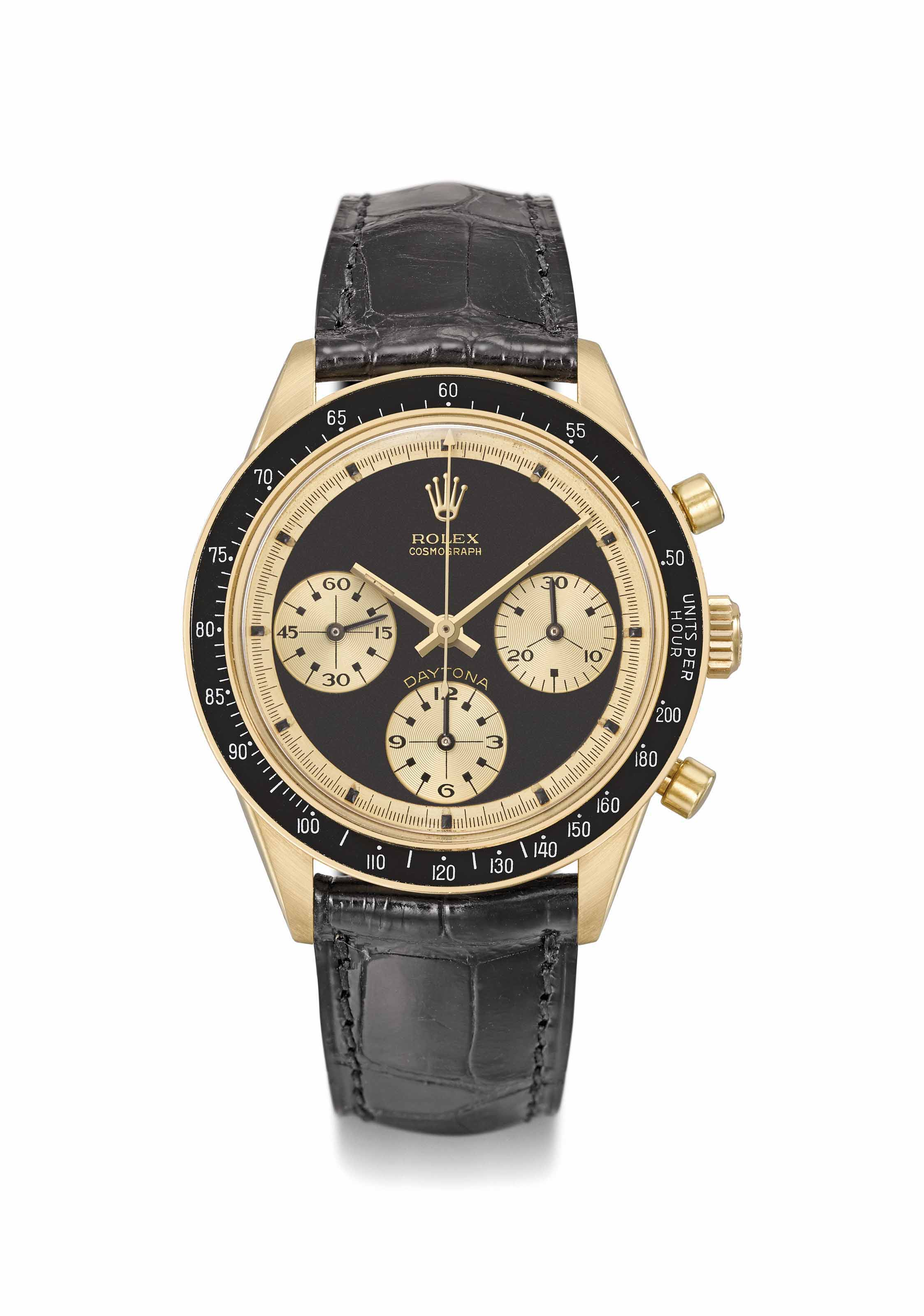 "Rolex. An exceptionally rare and highly attractive 18K gold chronograph wristwatch with black ""John Player Special Paul Newman"" dial"