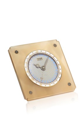 AN ART DÉCO AGATE, DIAMOND AND ENAMEL DESK CLOCK, BY CARTIER