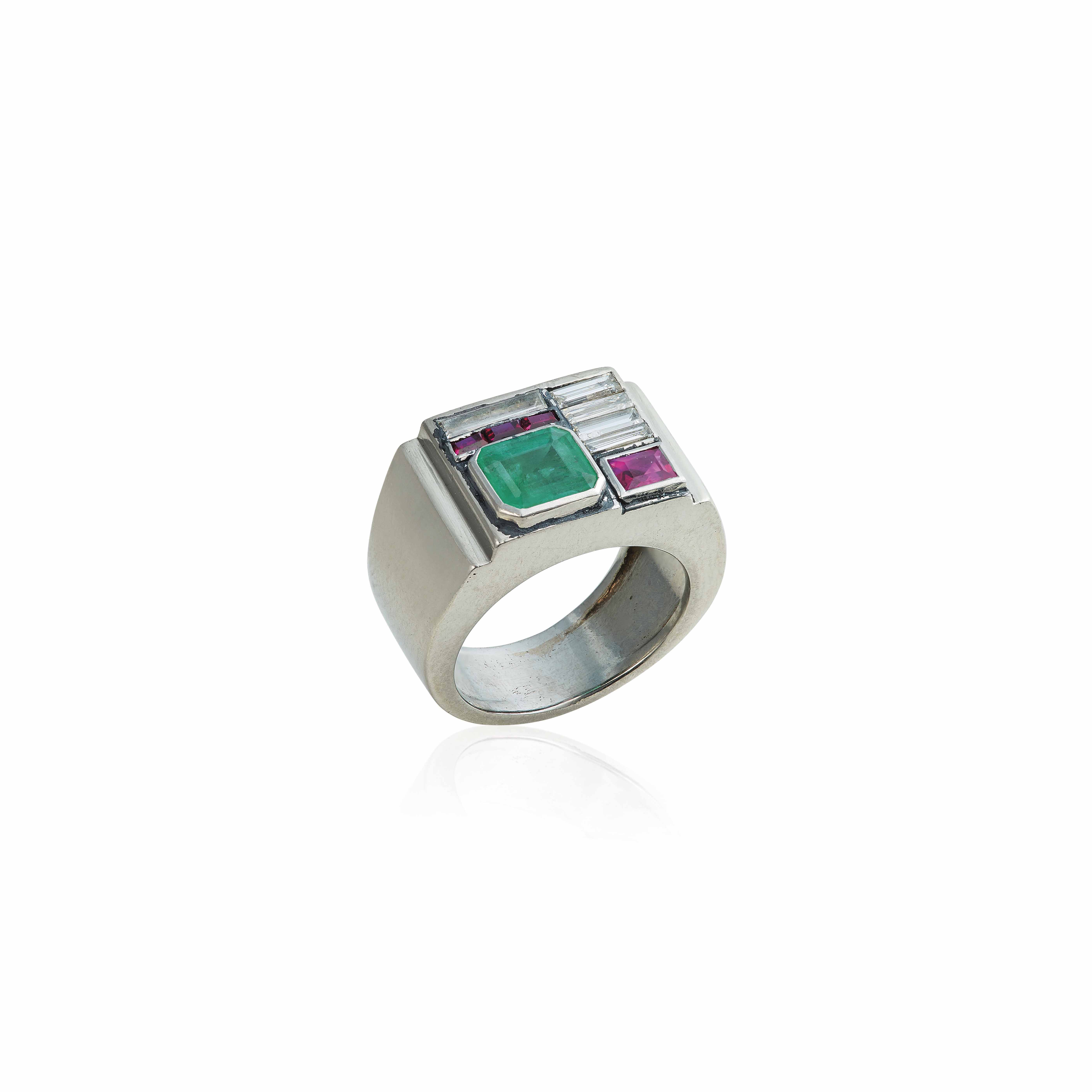 AN ART DÉCO EMERALD, DIAMOND AND SYNTHETIC RUBY RING, BY PAUL BRANDT