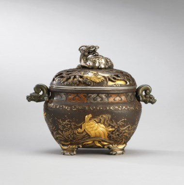 A gold and silver inlaid iron incense burner, late 19th century. 6¼  in (15.9  cm) wide, Japanese wood box. Estimate HK$260,000-350,000. This lot is offered in the Pavilion Sale                                                on 2 October 2017  at Christie's in Alexandra House, Hong Kong