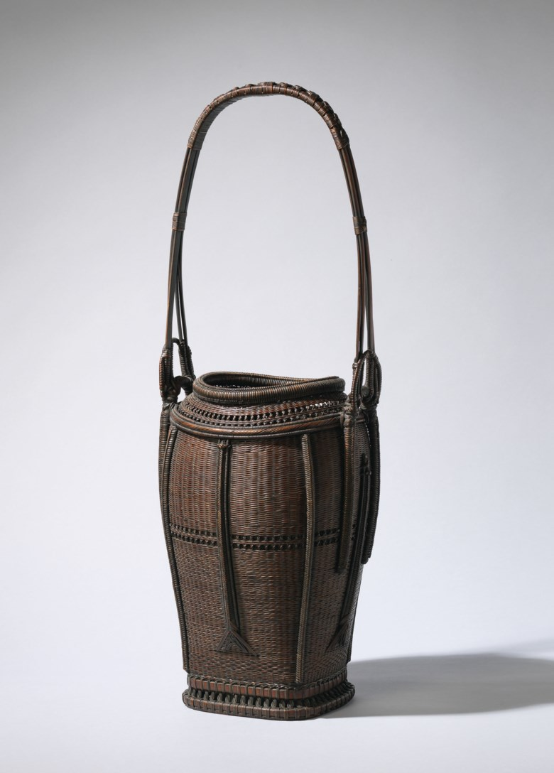 A bamboo basket for flower arrangement, signed Chikuhosai Kore Zo, Taisho-Showa period, 20th century. 23⅜ in (59.4 cm) high, Japanese wood box. This lot was offered in the Pavilion Sale on 2 October 2017 at Christie's in Hong Kong and sold for HKD 87,500
