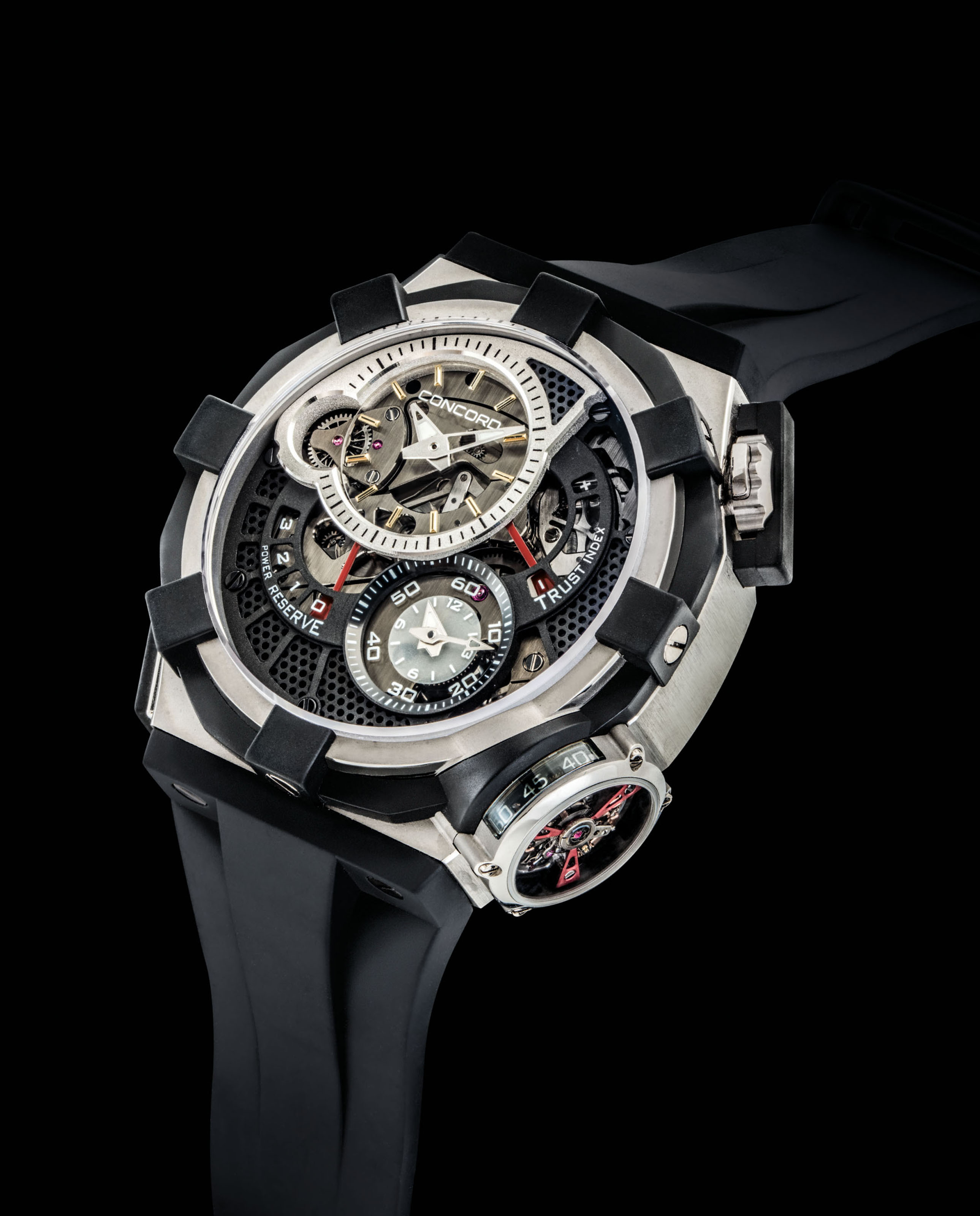 CONCORD. A FINE AND OVERSIZED STAINLESS STEEL AND RUBBER LIMITED EDITION SEMI-SKELETONISED FLYBACK CHRONOGRAPH TOURBILLON WRISTWATCH WITH POWER RESERVE AND TRUST INDEX INDICATION