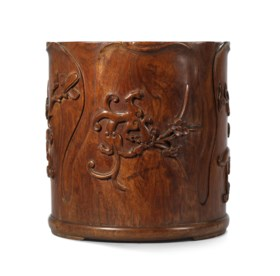 A VERY RARE AND FINELY CARVED HUANGHUALI 'CHILONG' FLORAL-FO