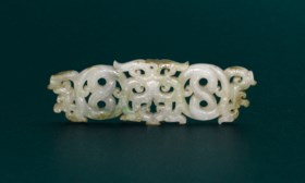 A WHITE JADE RETICULATED 'DRAGON AND PHOENIX' PENDANT