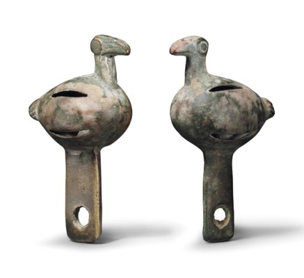 A PAIR OF BRONZE BIRD-FORM JIN