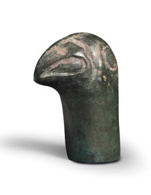 A BRONZE BIRD-HEADED FINIAL