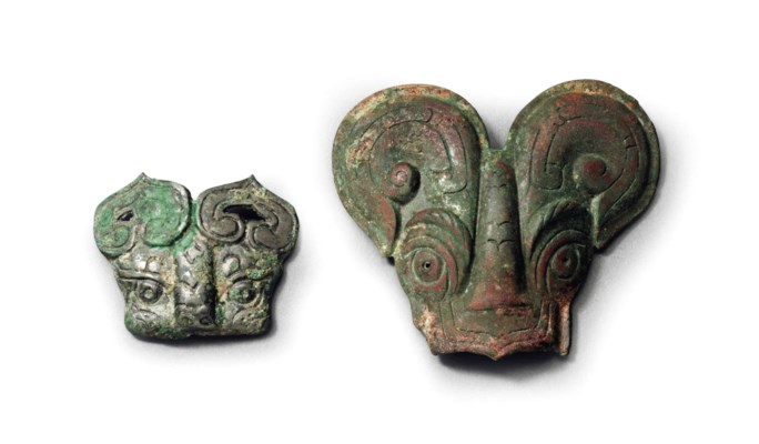 TWO BRONZE MASK-FORM HARNESS O