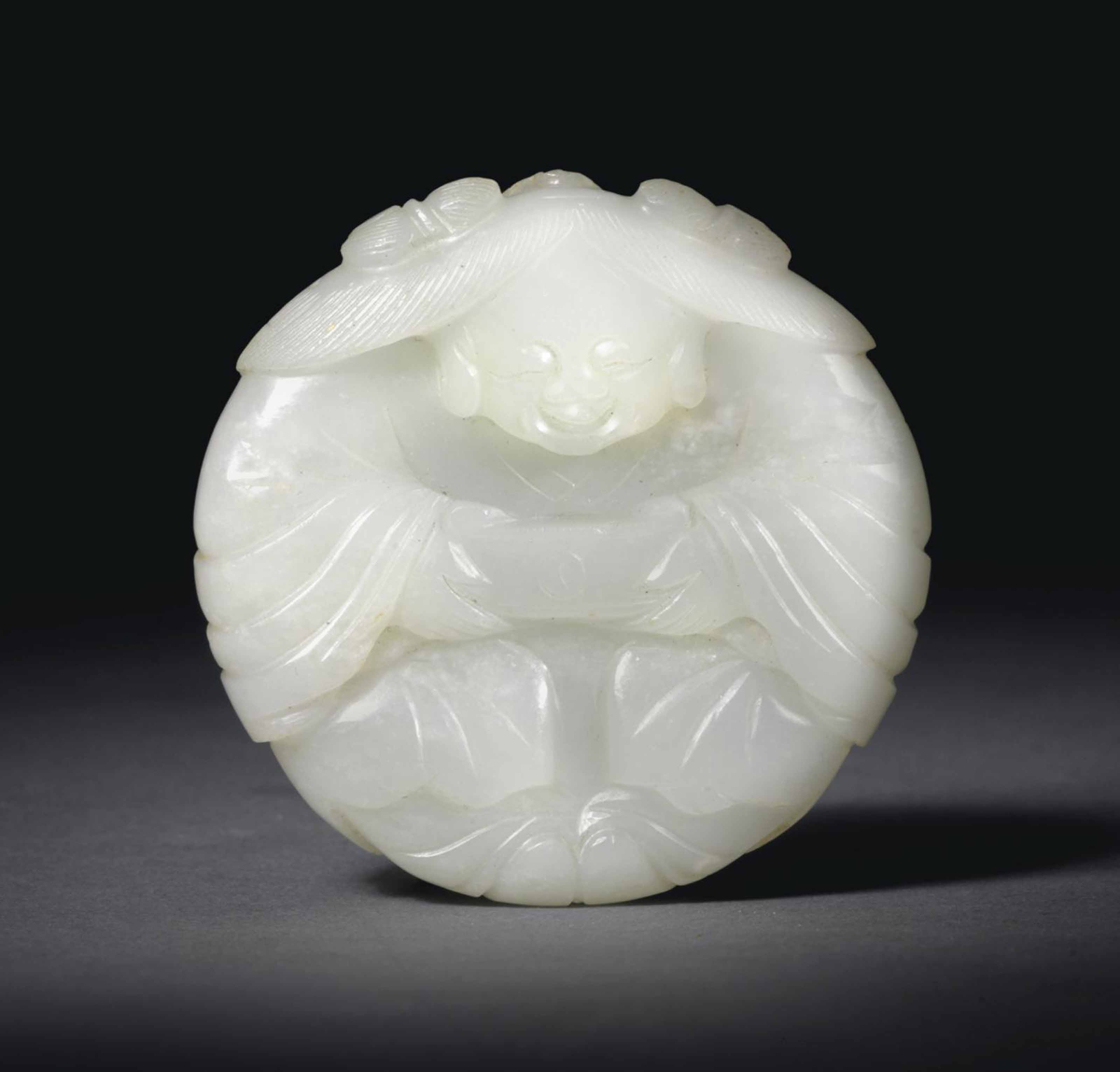 A WHITE JADE CIRCULAR FIGURAL