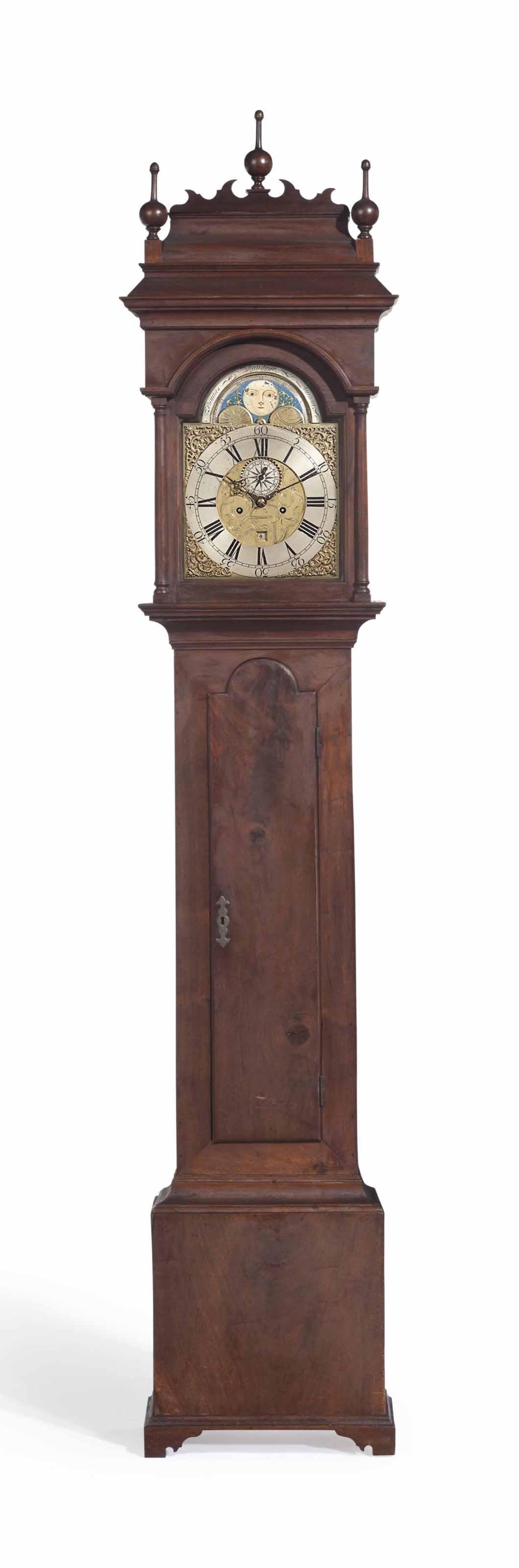 A QUEEN ANNE FIGURED WALNUT TALL-CASE CLOCK