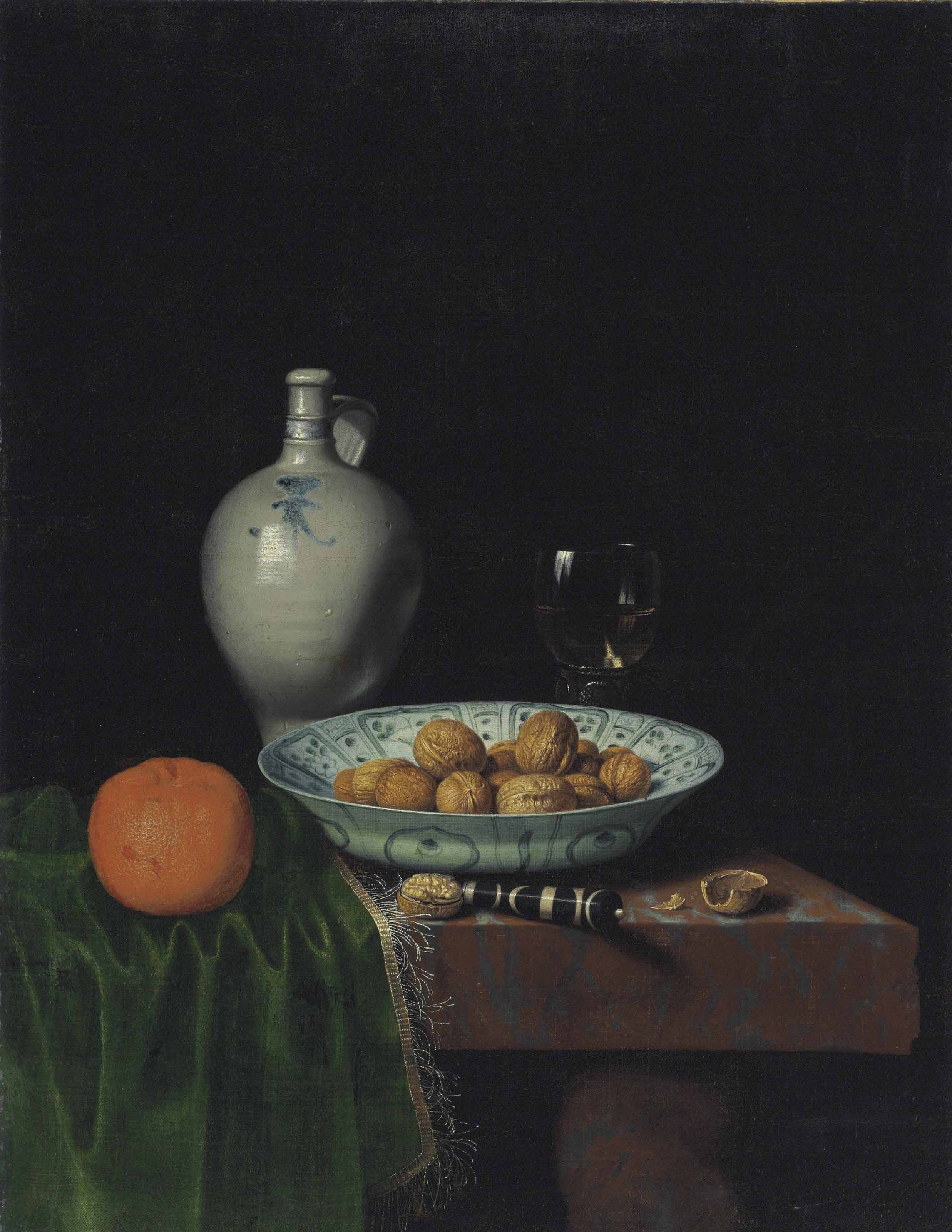 Walnuts in a wan-li porcelain bowl, an orange, a stoneware jug, a knife, and a roemer filled with wine on a partially draped marble table
