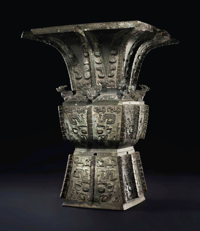 A magnificent and highly important bronze ritual wine vessel, Fangzun, late Shang dynasty, Anyang, 13th-11th century BC. 20⅝ in (52.4 cm) high, gold and silver-inlaid wood stand, Japanese double wood box, metal liner, inscribed with cyclical date Gui Hai year, corresponding to 1923. Sold for $37,207,500 on 15 March 2017  at Christie's in New York