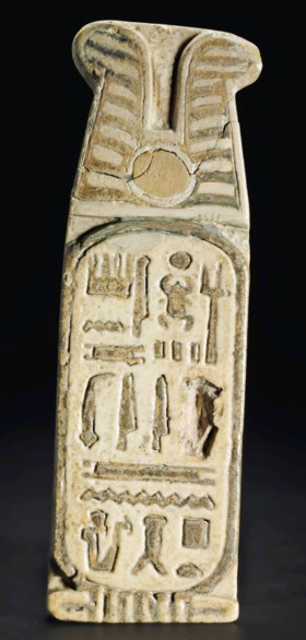 AN EGYPTIAN FAIENCE PLAQUE WITH THE CARTOUCHE OF SETI II