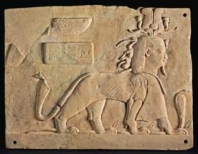 AN EGYPTIAN LIMESTONE PLAQUE OF TUTU