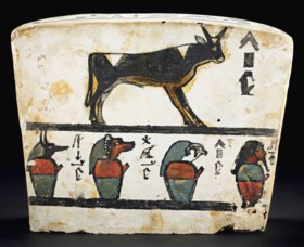 AN EGYPTIAN PAINTED WOOD COFFIN BASE FOR PA-IUIU