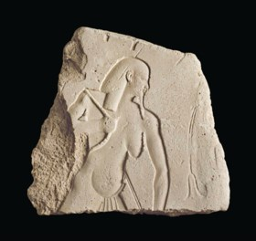 AN EGYPTIAN PLASTER RELIEF FRAGMENT WITH HAPY