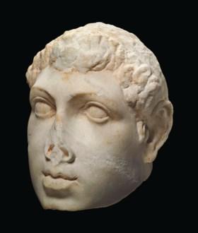 A GREEK MARBLE PORTRAIT HEAD OF PTOLEMY VIII