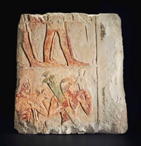 AN EGYPTIAN PAINTED LIMESTONE RELIEF FRAGMENT FROM THE TOMB OF NY-ANKH-NESU
