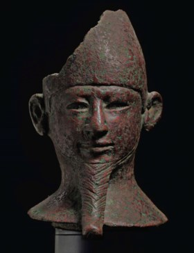 AN EGYPTIAN BRONZE HEAD OF A GOD