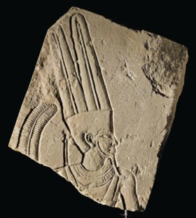 AN EGYPTIAN LIMESTONE RELIEF FRAGMENT WITH AMUN