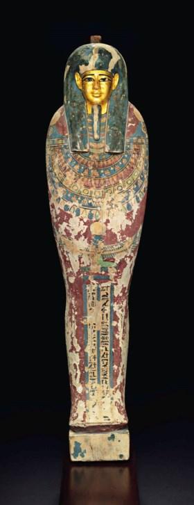 AN EGYPTIAN GILT AND PAINTED WOOD PTAH-SOKAR-OSIRIS