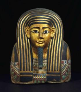 AN EGYPTIAN GILT AND PAINTED WOOD MASK